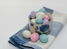 Malted Milk Eggs. Candy in a ceramic bowl on napkin.  Copy space and close up Royalty Free Stock Photos