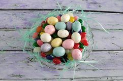 Malted Milk Eggs and Jelly Beans. Malted milk eggs candy and jelly beans in a glass dish Stock Photography
