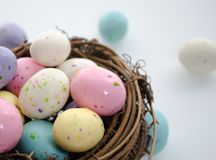Malted Milk Eggs. Candy in an Easter nest.  Shallow depth of field Royalty Free Stock Photography