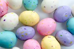 Malted Milk Eggs. Speckled pastel malted milk egg candy. Could be used as a background or for a greeting card Stock Photo