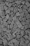 Malted shredded wheat biscuits background. Malted shredded wheat biscuits breakfast cereal as an abstract background texture - monochrome processing Stock Photography