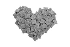 Malted wheat biscuits breakfast cereal heart. Malted wheat biscuits breakfast cereal in a heart shape, isolated on a white background - monochrome processing Royalty Free Stock Images
