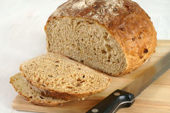 Malted wholemeal loaf. Sliced on a bread board Royalty Free Stock Images