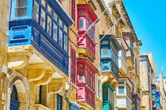 Maltese architectural details, Valletta. The scenic wooden Maltese balconies, covered with different paints, are traditional architectural detail of historical Royalty Free Stock Images