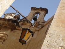 Maltese architecture. Bell and streetlight in the sleeping city Stock Photography