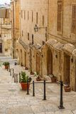 Maltese architecture in Valletta, Malta. Narrow street and stairs with old houses, Traditional Maltese architecture in Valletta, Malta Royalty Free Stock Image