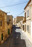 Maltese architecture in Valletta, Malta. Traditional narrow street in Malta. Maltese architecture in Valletta, Malta Royalty Free Stock Photography