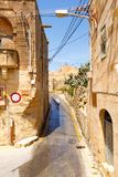 Maltese architecture in Valletta, Malta. Traditional narrow street in Malta. Maltese architecture in Valletta, Malta Stock Photography