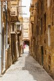 Maltese architecture in Valletta, Malta. Traditional narrow street in Malta. Maltese architecture in Valletta, Malta Royalty Free Stock Photos