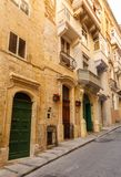 Maltese architecture in Valletta, Malta. Traditional narrow street and old houses in Malta. Maltese architecture in Valletta, Malta Stock Photo