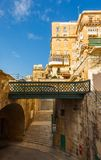Maltese architecture in Valletta, Malta. Traditional narrow street, old houses, arch, tunnel and footbridge in Malta. Maltese architecture in Valletta, Malta Royalty Free Stock Photography