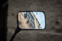 Maltese balconies in the mirror sky. A typical Maltese balcony is reflected in a motorcyle mirror Stock Photo