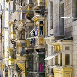 Maltese balconies in Valletta. Typical narrow street on the island of Malta. Buildings with traditional colorful maltese balconies in historical part of Royalty Free Stock Photo