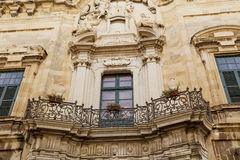 Maltese balcony. A typical Maltese balcony with a fancy wrought iron railing Stock Photo