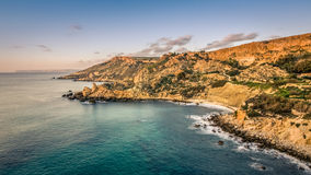Maltese bay in sunset. Maltese rocky bay in sunset with turquoise colored sea Stock Photography