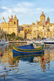 Maltese boat luzzu moored in the harbor in Dockyard creek. Bir. VALLETTA, MALTA - JULY 31, 2015: The Maltese boat luzzu moored in the harbor of Dockyard creek in Stock Photography