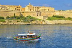 Maltese boat and Valletta views. View of Valletta - the capital of Malta Royalty Free Stock Images