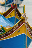 Maltese Boats. Brightly painted fishing boats with the Eyes of Osiris in Marsaxlokk on the island of Malta Stock Photos