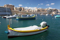 Maltese boats. Boats moored under the walls of Birgu City, Grand harbour, Malta Royalty Free Stock Photography