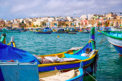 Maltese boats. Traditional wooden fisherman's boats in Marsaxlokk town. Malta Stock Photography