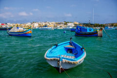 Maltese boats. Traditional wooden fisherman's boats in Marsaxlokk town. Malta Stock Photos