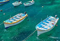 Maltese boats on transparent green water of Wied Zurrieq Fjord. On south end of Malta island Royalty Free Stock Photography