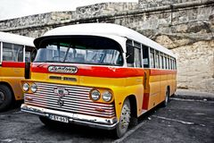 Maltese bus. La Valetta, Malta - January 5, 2011: a classic yellow bus at the main bus station in Valetta Stock Image