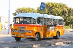 Maltese bus waiting at bus stop Stock Photos