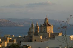 Maltese chapel at sunset. Maltese small chapel at sunset. Beautiful sunset. Visit Malta if you ever get a chance for more scenes like this one Royalty Free Stock Image