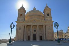 Maltese church. Awe-inspiring view of a Maltese church with sun behind church tower Stock Images