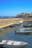 Malta, Coastline view. Vessels moored in the boat shelter, old part of fishing village of St Pauls Bay, San Pawl il-Baħar, Malta Stock Images