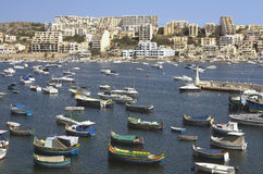 Malta, Coastline view. Fishing harbour in the St Pauls Bay and panorama of Xemxija in the background - San Pawl il-Baħar, Malta Royalty Free Stock Image