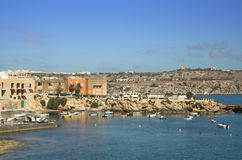 Malta, Coastline view. Buildings in the old part of fishing village of St Pauls Bay - San Pawl il-Baħar, Malta Royalty Free Stock Photo