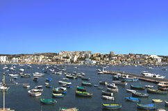 Malta, Seaside view. Fishing harbour in the St Pauls Bay and panorama of Xemxija in the background - San Pawl il-Baħar, Malta Stock Images