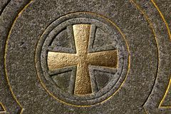 Maltese cross. In stone and gold Stock Image