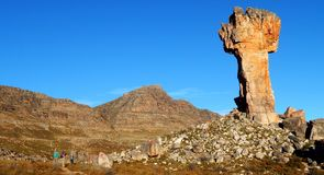 Maltese cross in the Cedarberg Mountains. The famous Maltese cross in the Cedarberg Mountains with a group of hikers admiring it stock photos