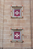 Maltese cross is the symbol associated with the Order of St. Joh. Maltese cross on a church. The cross symbol associated with the Order of St. John since 1567 Royalty Free Stock Images