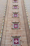 Maltese cross is the symbol associated with the Order of St. Joh. Maltese cross on a church. The cross symbol associated with the Order of St. John since 1567 Royalty Free Stock Image