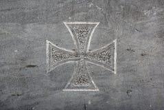 Maltese cross. On grey stone royalty free stock image