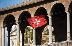 Maltese Cross in Rome. Maltese Cross on Knight of Malta flag in Trajan Forum, Rome Stock Photo