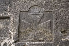 Maltese cross monument  dated 1896. The Maltese cross is the cross symbol associated with the Order of St. John since 1567, with the traditional Knights Stock Images