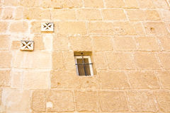 Maltese cross wall. Decorations and window on old wall in Mdina, Malta royalty free stock photo