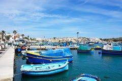 Maltese Dghajsa boats in the harbour, Marsaxlokk. Stock Photography