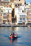 Maltese Dghajsa water taxi, Vittoriosa. Royalty Free Stock Image