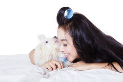 Maltese dog licking face of woman Stock Photography