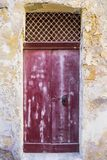 Maltese door in Valletta. Building with traditional maltese door in historical part of Valletta. Entrance to an abandoned house on the island of Malta Stock Images