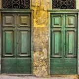 Maltese doors in Valletta. Building with traditional maltese doors in historical part of Valletta. Entrance to an abandoned house on the island of Malta Stock Photos