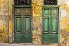 Maltese doors in Valletta. Building with traditional maltese doors in historical part of Valletta. Entrance to an abandoned house on the island of Malta Stock Image