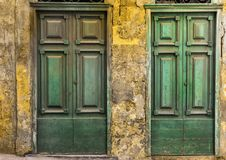 Maltese doors in Valletta. Building with traditional maltese doors in historical part of Valletta. Entrance to an abandoned house on the island of Malta Royalty Free Stock Images
