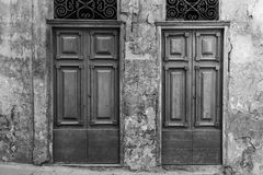 Maltese doors in Valletta. Building with traditional maltese doors in historical part of Valletta. Entrance to an abandoned house on the island of Malta. Black Royalty Free Stock Photos